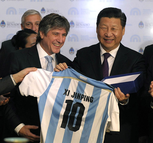 China's President Xi Jinping  receives an Argentine soccer jersey with his name