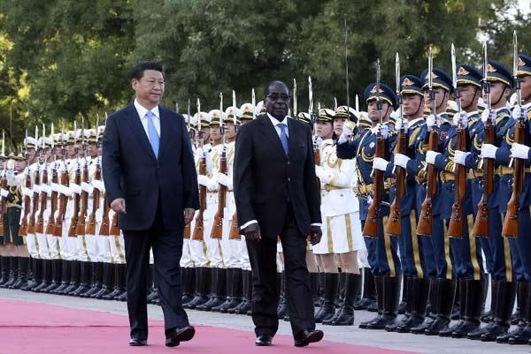 President Xi Jinping and Zimbabwean President Robert Mugabe