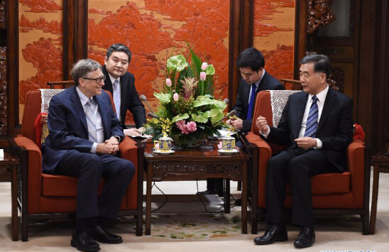 Chinese Vice Premier Wang Yang (R) meets with Bill Gates, founder and chairman of TerraPower