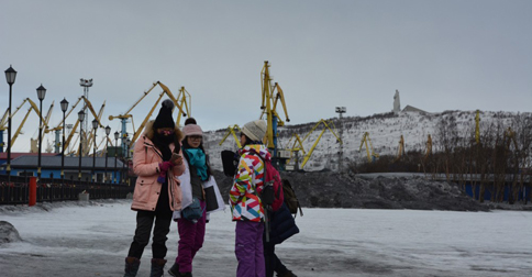 Chinese tourists on the Murmansk waterfront.
