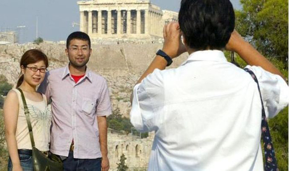 Chinese Tourists took photos at Greece attractions